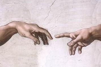 Hand of God reaching out to Adam who receives it